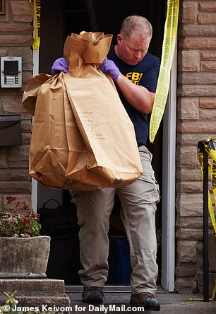 FBI agents at the scene on Wednesday seized evidence from the home after it authorities said